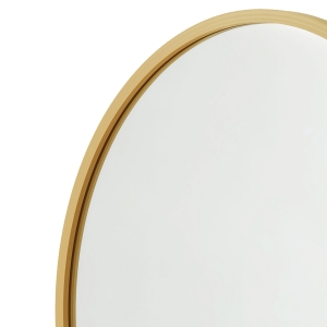 Close-up angle shot of matte gold rubber framed round mirror
