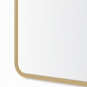 Close-up angle shot of matte gold rubber framed rectangle mirror