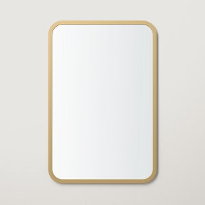 Matte gold rubber framed rectangle mirror hanging on beige wall