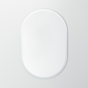 Frameless beveled racetrack oval mirror hanging on beige wall