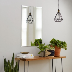 Frameless beveled rectangle mirror copper-free hanging on wall above side table