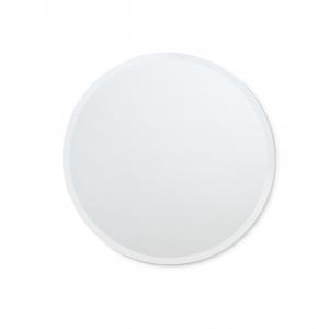 Frameless beveled round mirror hanging on white wall