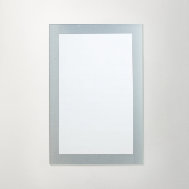 Frosted border rectangle mirror hanging on beige wall