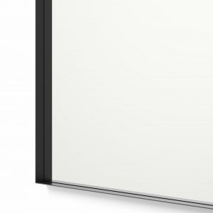 Close-up angle shot of black framed rectangle mirror