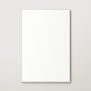 White metal framed rectangle mirror hanging on beige wall