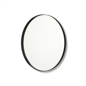Angled view of black framed metal framed round mirror