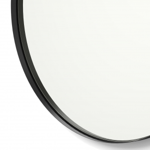 Close-up angle shot of black framed round mirror