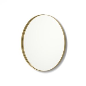 Angled view of gold framed metal framed round mirror