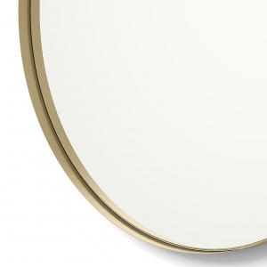 Close-up angle shot of gold framed round mirror