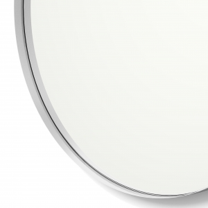 Close-up angle shot of silver framed round mirror
