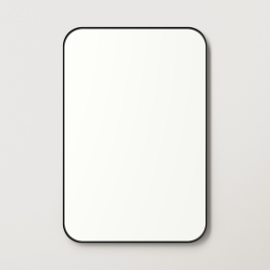 Black metal framed rounded rectangle mirror hanging on beige wall