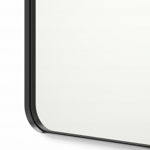 Close-up angle shot of black framed rounded rectangle mirror