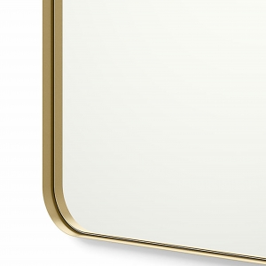 Close-up angle shot of gold framed rounded rectangle mirror