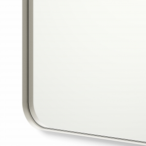 Close-up angle shot of nickel framed rounded rectangle mirror