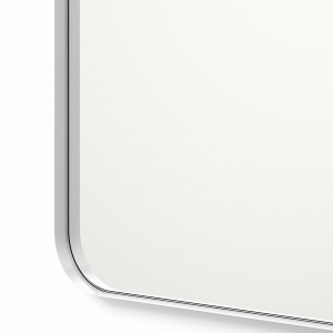 Close-up angle shot of silver framed rounded rectangle mirror