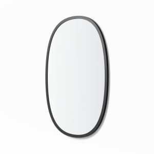 Angled view of black rubber framed oval mirror