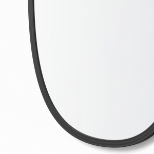 Close-up angle shot of black rubber oval mirror