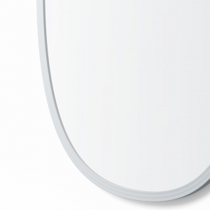 Close-up angle shot of grey rubber oval mirror