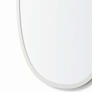 Close-up angle shot of white rubber oval mirror