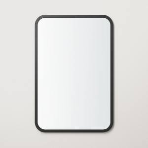 Black rubber framed rectangle mirror hanging on beige wall