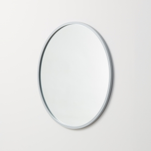 Angled view of grey rubber framed round mirror