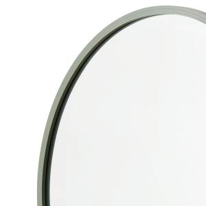 Close-up angle shot of sage green rubber round mirror