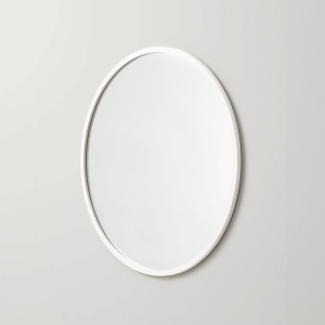 Angled view of white rubber framed round mirror